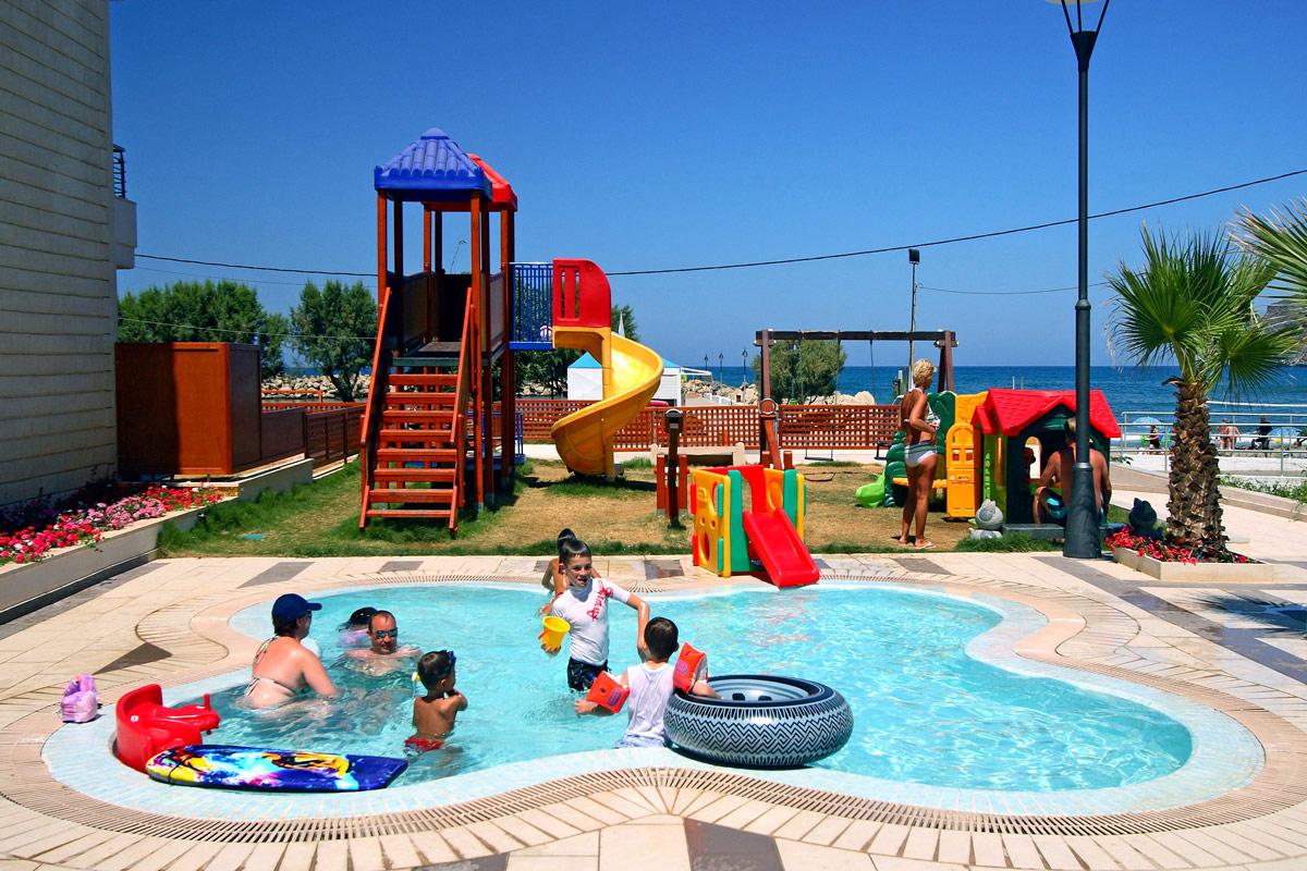 Facilities of porto platanias beach resort in platanias for Children s garden pools