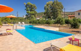 Traditional Stone Villas, Kalyves, Pool area with sunbeds
