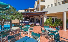 Theos Village Apartments, Chrissi Akti, Restaurant by the pool