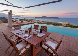 Pasiphae Sea View Villa, Stalos, exterior dining area sunset